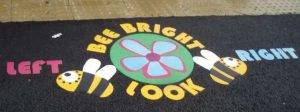 Thermoplastic markings can be used to highlight safe places to cross the road to school