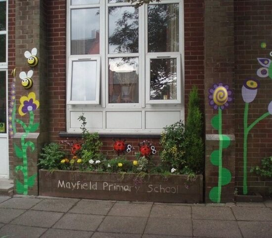 A 3D mural designed with the pupils transforms the school entrance to an inviting and welcoming area